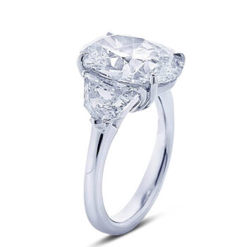 3 stone oval diamond engagement ring with trapezoid diamond side stones