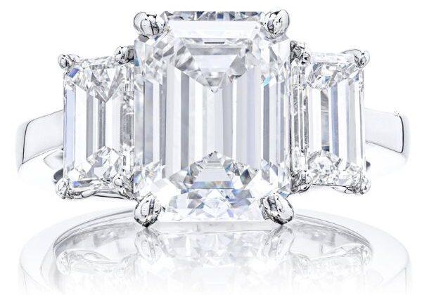 A Cassic Emerald Trinity Three Stone Ring