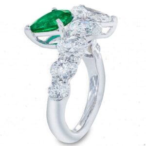 pear diamond and pear emerald toi et moi rings or two stone diamond settings