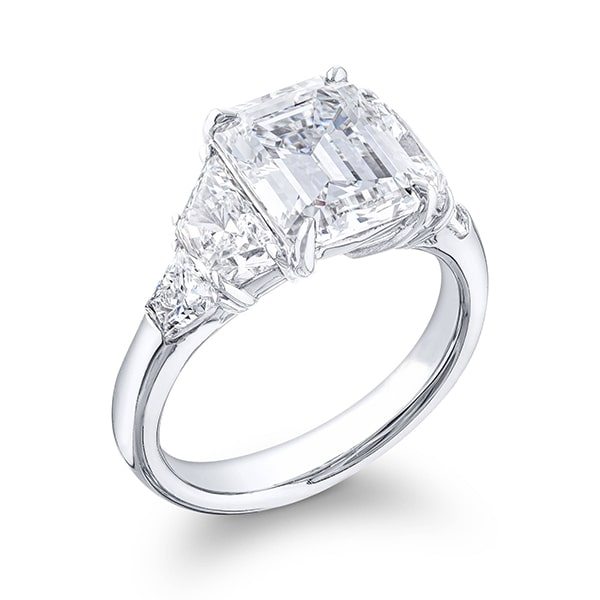 5 stone diamond engagement ring with emerald and brilliant cut trapezoid diamond side stones