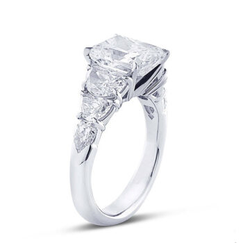 7 stone ring with radiant cut and half moond cut diamond side stones