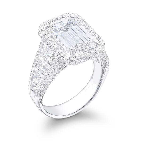 micro pave emerald with brilliant trapezoid dismonds in platinum