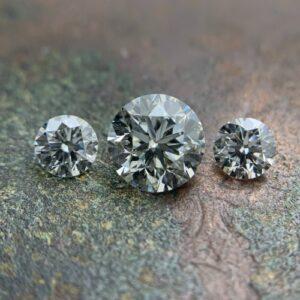 three brilliant round cut diamonds