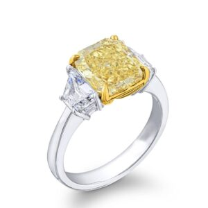 three stone diamond engagement ring with step cut trapezoid side stones and fancy yellow radiant