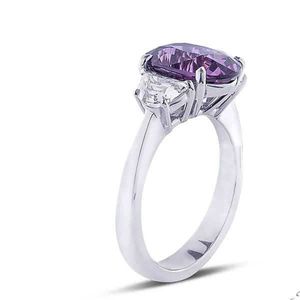 three stone diamond ring with purple sapphire and half moon step cut diamond side stones