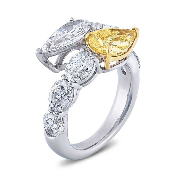 two stone pear cut diamond ring with fancy yellow pear and oval cut side stones