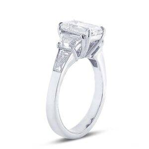 5 stone diamond engagement ring with emerald center and step cut trapezoid with tapered baguette diamonds