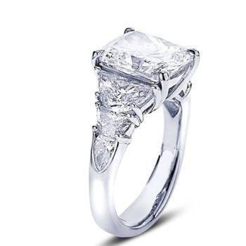 cushion cut diamond engagement ring with half moon and shield site stone diamonds